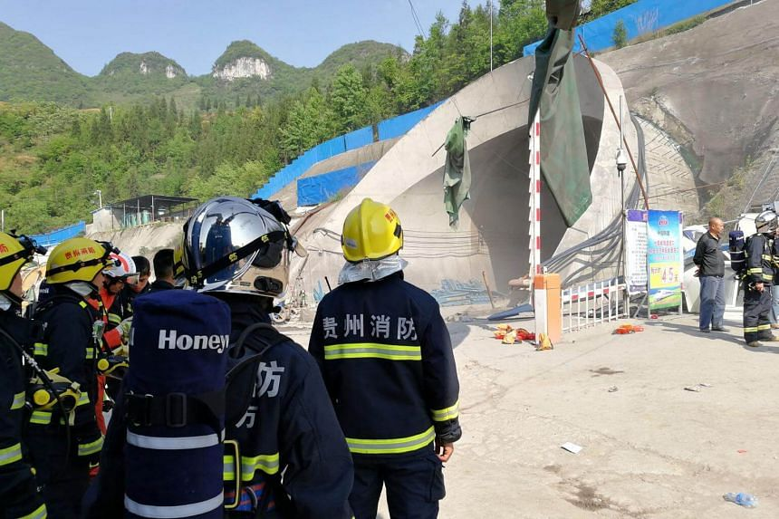Rescuers gather near the site of an explosion at a railway tunnel in Dafang County of Bijie City, Guizhou Province, China on May 2, 2017.