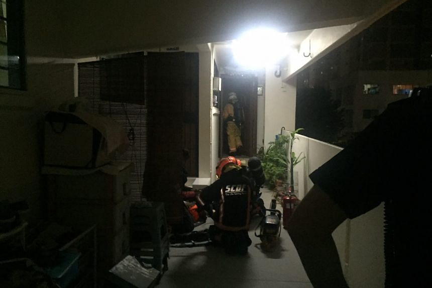 SCDF officers respond to a fire at Block 846, Tampines Street 82, on May 3, 2017.