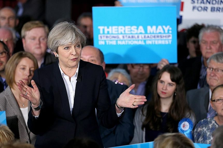 British Prime Minister Theresa May speaking to party members in Mawdsley, Britain, on Monday.