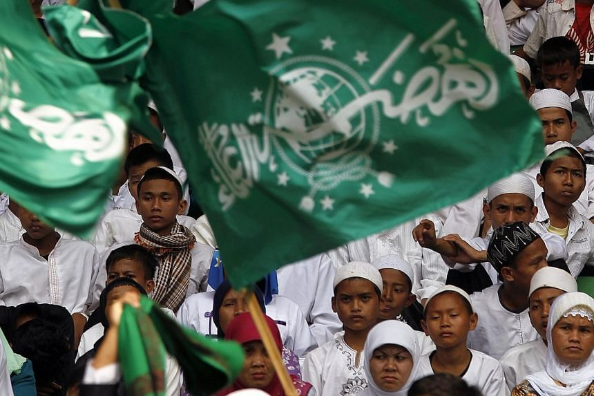 Members commemorating Nahdlatul Ulama's 85th anniversary in 2011. The world's largest mass Islamic organisation is behind a global initiative to reinterpret Islamic law dating from the Middle Ages in ways that conform to 21st-century norms.