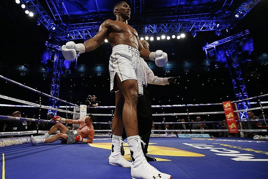 Briton Anthony Joshua reacts after knocking down boxing great Wladimir Klitschko during their heavyweight title fight at Wembley.