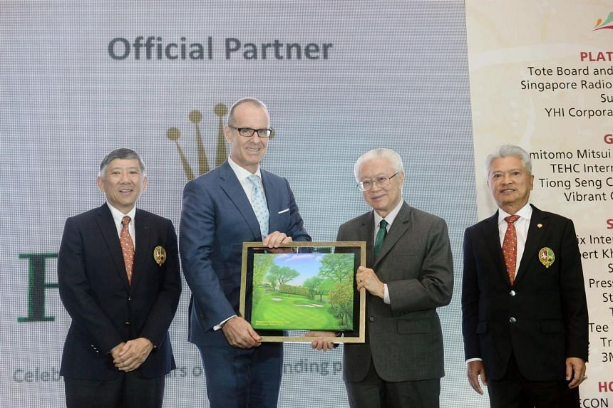 President Tony Tan (second from right) presenting a memento to Rolex Singapore CEO Chris Gisi as SICC Chairman Khoo Boon Hui (extreme left) and SICC May Day Charity Organising Chairman Andrew Lim look on.