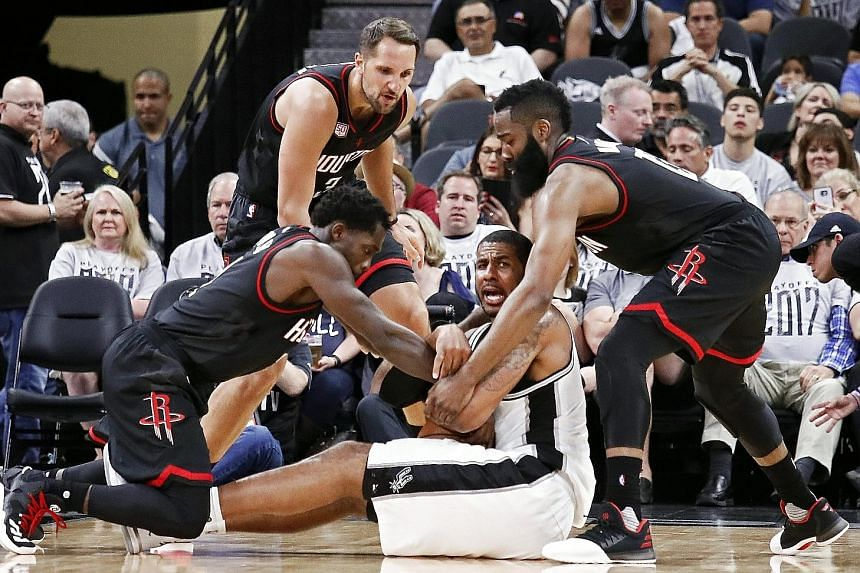 San Antonio Spurs forward LaMarcus Aldridge calling for help after being trapped by Houston Rockets' James Harden (right), Patrick Beverley (left) and Ryan Anderson. Aldridge had a poor Game One, scoring only four points.