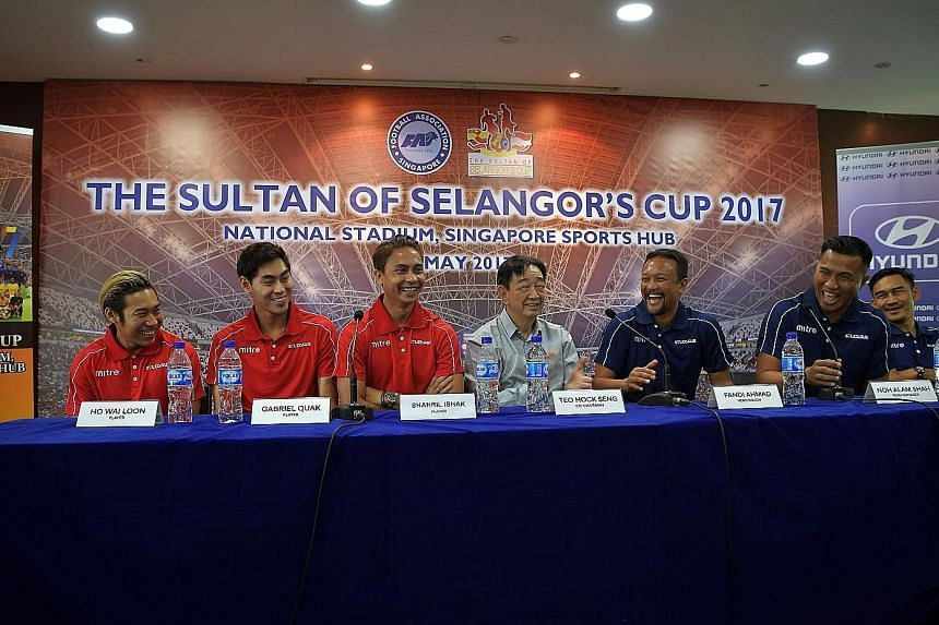 Smiles all around the Singapore camp - (from left) players Ho Wai Loon, Gabriel Quak and Shahril Ishak, Sultan of Selangor Cup co-chairman Teo Hock Seng, Singapore Selection head coach Fandi Ahmad, team manager Noh Alam Shah and assistant coach Nazri