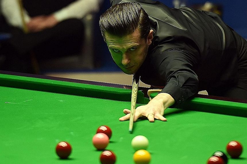 Englishman Mark Selby playing a shot during the world snooker championship final.
