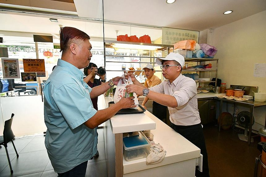 Mr Gary Lim has apologised in a phone call last Saturday to the taxi driver he mocked. Following the apology, he pledged to give out free packets of chicken rice to taxi drivers at his two outlets yesterday. Cabby Mr Wang collecting his chicken rice