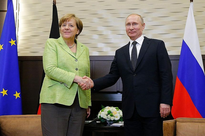 Dr Angela Merkel meeting Mr Vladimir Putin in Sochi yesterday. She said a ceasefire is required as part of the Minsk process for peace in eastern Ukraine and appealed to the Russian leader to make it happen.