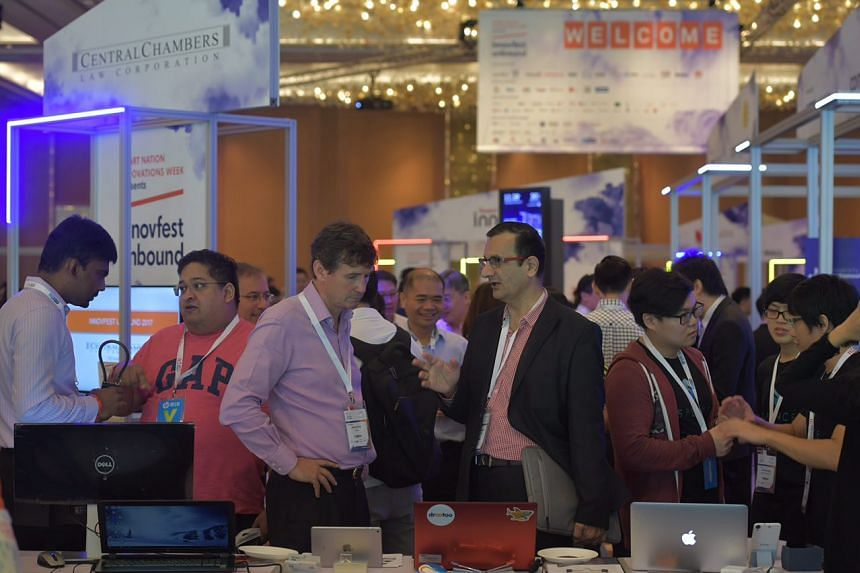 People attend the Innovfest Unbound conference at the Marina Bay Sands Expo and Convention Centre.