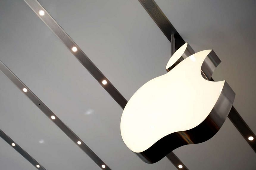 The Apple logo is pictured inside the newly opened Omotesando Apple store at a shopping district in Tokyo.