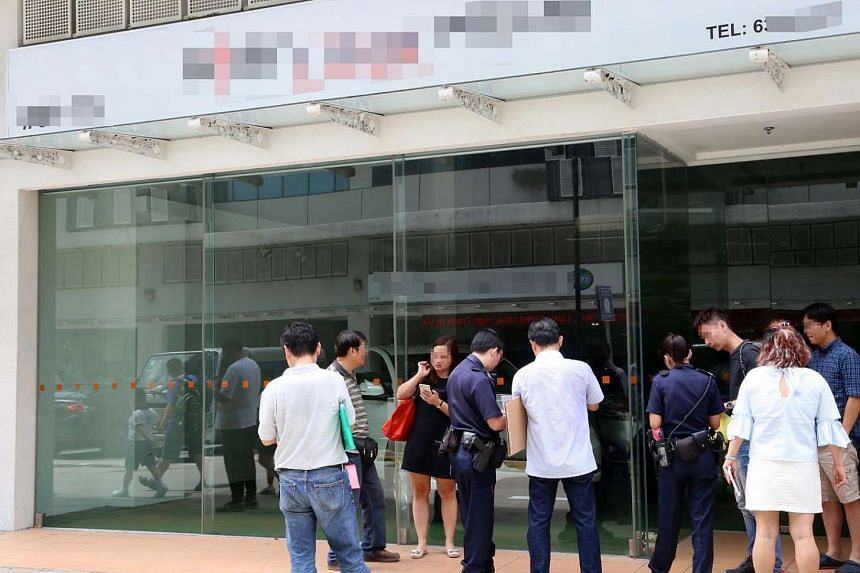 Concerned buyers and police officers seen outside Star Link's office at Midview City on Tuesday (May 2).