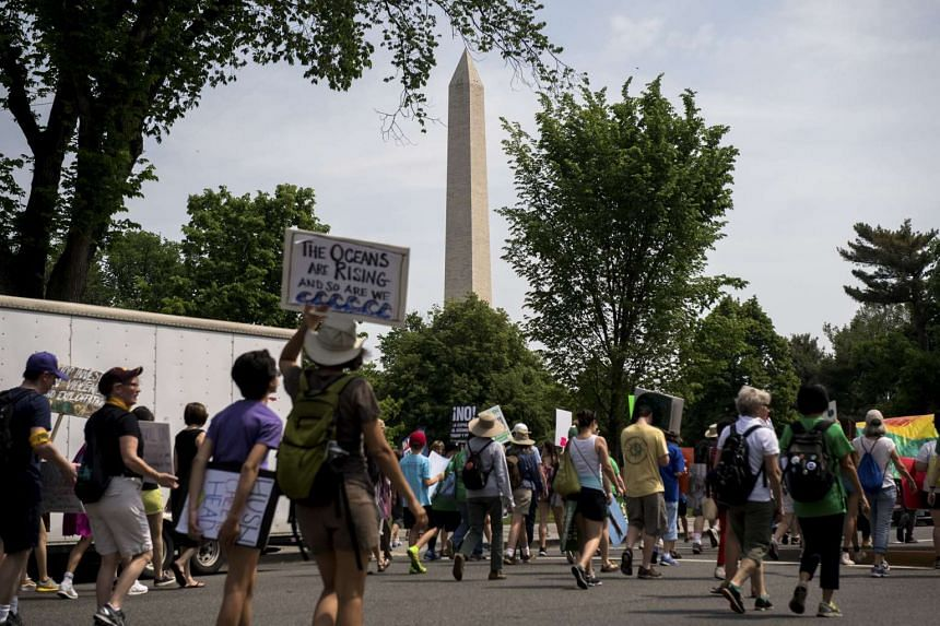 Demonstrators walking from the White House toward the Washington Monument during the Climate March.