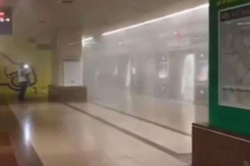 A platform at Raffles Place MRT station was filled with smoke after a train suffered a freon gas leak.