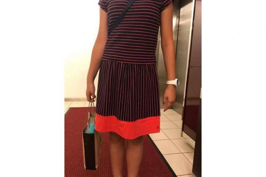 """During a tournament in Putrajaya on April 14, a 12-year-old girl was told mid-game by the chief arbiter that her short-sleeved knee-length dress was """"improper"""" and she would not be allowed to wear a similar dress for the next round."""