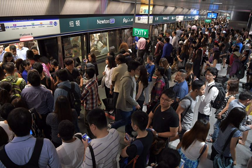 Commuters at Newton MRT station on the Downtown Line.