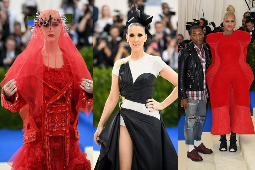 (From far left) Singer Katy Perry in an over-the-top bride-of- Frankenstein gown by Maison Martin Margiela, singer Celine Dion in an asymmetrical Versace gown, and Pharrell Williams and his wife, Helen Lasichanh, in a Comme des Garcons gown with no a