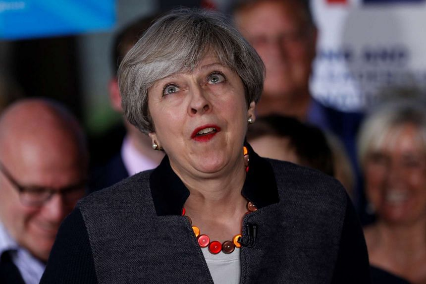 """British Prime Minister Theresa May dismissed the report as """"Brussels gossip""""."""