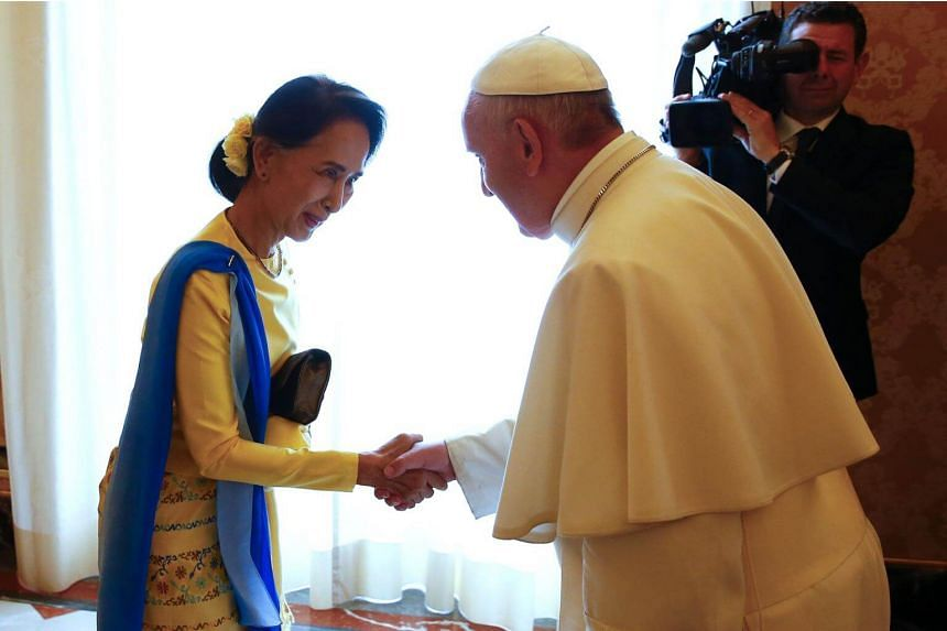 Myanmar's State Counsellor and Foreign Minister Aung San Suu Kyi meets Pope Francis during a private audience on May 4, 2017 at the Vatican.