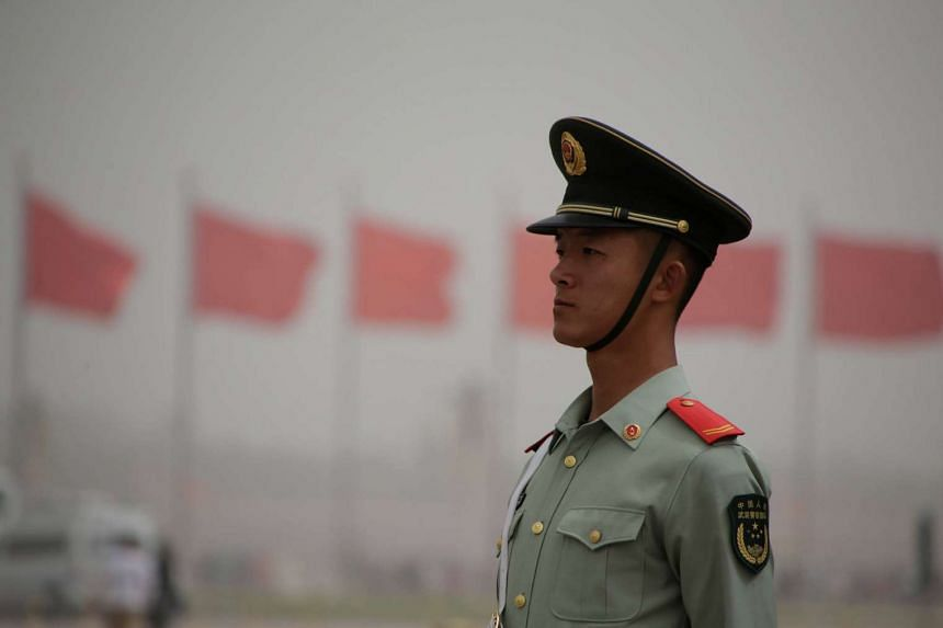A paramilitary police officer stands guard at Tiananmen Square as a dust storm hits Beijing, China on May 4, 2017.