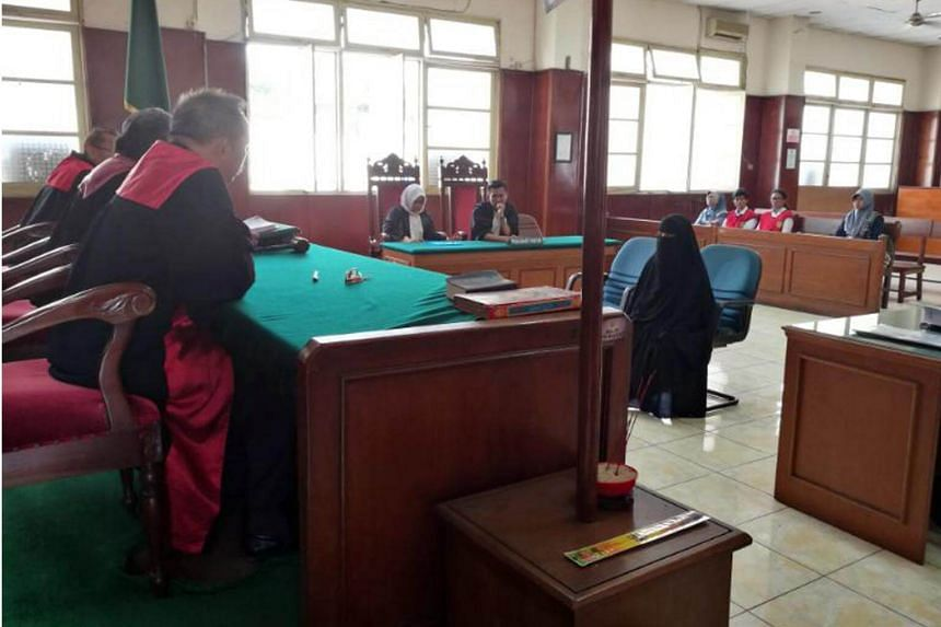 Jumiatun (in black burqa), the widow of Indonesian militant Santoso, was jailed for two years and three months for harbouring him.