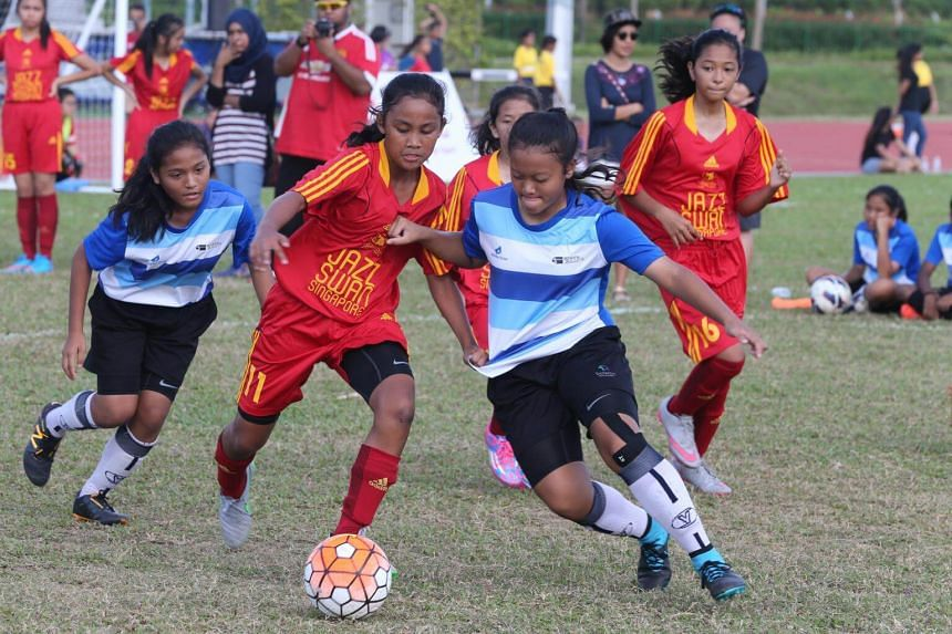 Girls in action at the second annual Women's Football Day at the Home of Athletics on Feb 28, 2016.