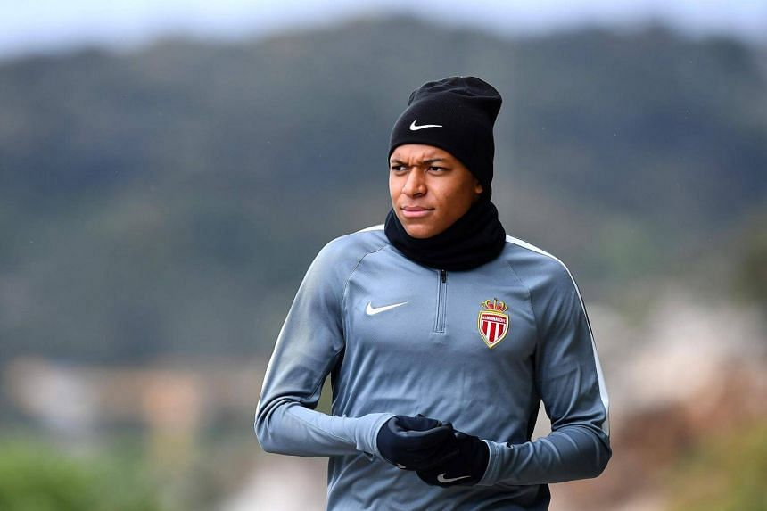 Monaco's French forward Kylian Mbappe arrives for a training session on May 2, 2017 in La Turbie.