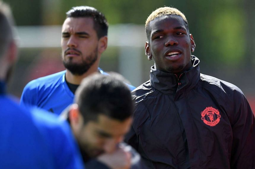 Midfielder Paul Pogba (right) attends a team training session on May 3, 2017.