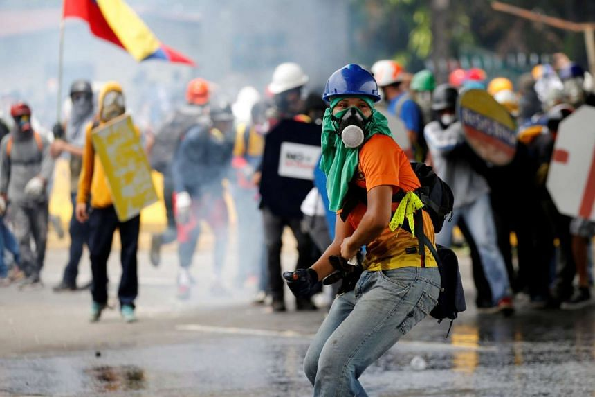 Opposition supporters clash with riot police, May 3, 2017.