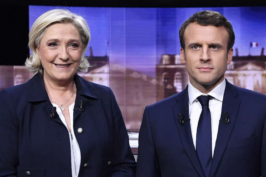 Presidential candidates Le Pen (left) and Macron pose ahead of the live televised debate.