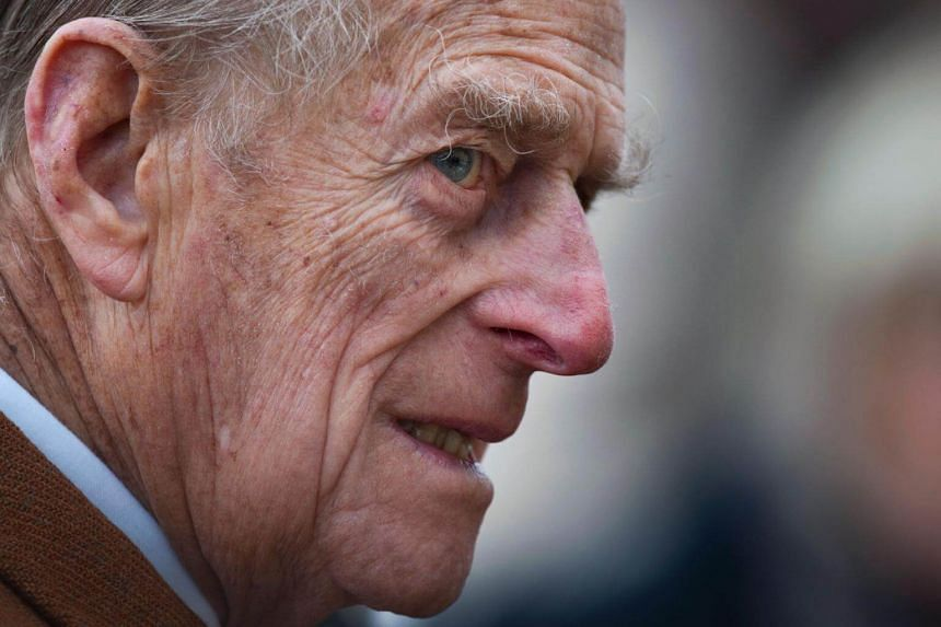 Britain's Prince Philip leaves a church service at St Peters and St Paul in West Newton, Norfolk, on Feb 5, 2012.