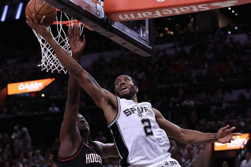 Kawhi Leonard of the San Antonio Spurs drives against Clint Capela of the Houston Rockets during Game Two of the NBA Western Conference Semi-Finals on May 3, 2017.