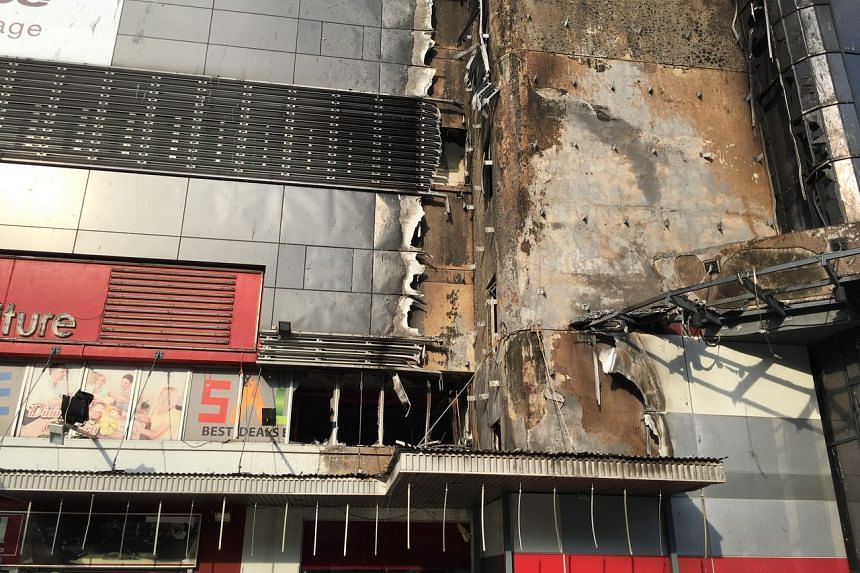 The aftermath of a fire that broke out in an eight-storey building at 30 Toh Guan Road on May 4, 2017.