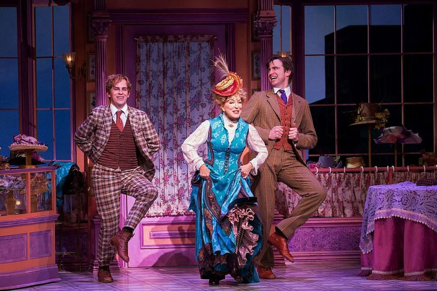 Actress Bette Midler in Hello, Dolly!, with co-stars Taylor Trensch (far left) and Gavin Creel.