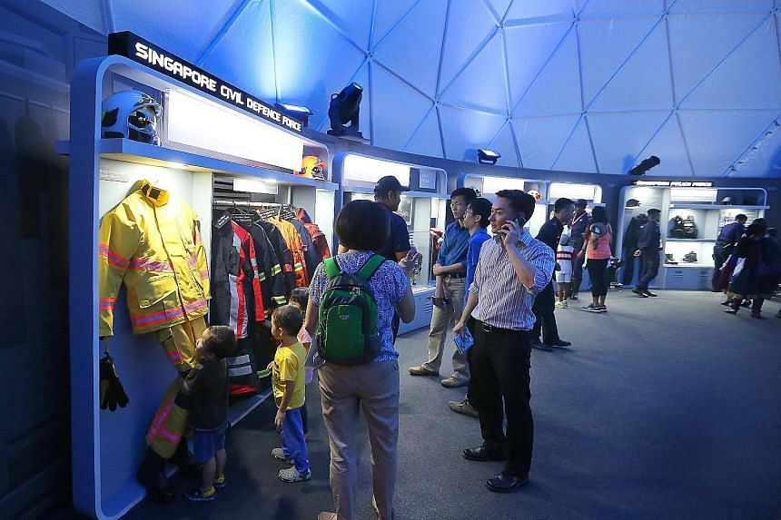 The What We Do zone at the festival showcases the capabilities of various agencies and also gives visitors a chance to become more familiar with various equipment the Home Team members use, such as a fireman's protective gear. The Singapore Civil Def