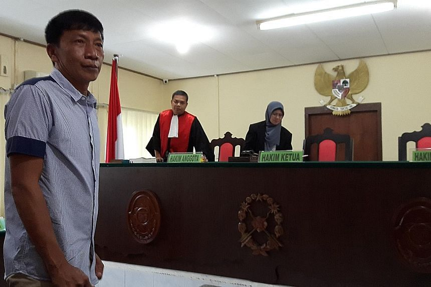 Above: Shoo Chiau Huat at a court hearing in Tanjung Pinang last October. A prosecution appeal against his acquittal for illegal fishing is still pending. Left: Mr Ricky Tan Poh Hui was released from the Tanjung Pinang Naval Base on Tuesday after he