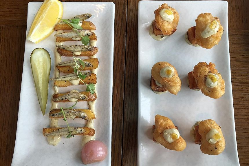 The dish in contention - Fish & Chips (far left), with whitebait, thick-cut potato, 33.1 Blond Lager pickles and tartar sauce - is in LeVeL33's Beer Dining menu and costs $13. The one on the right is the old version of the dish. It used dory fish and