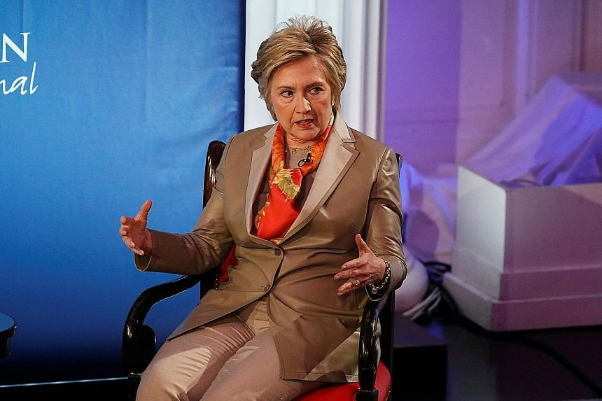 """Mrs Hillary Clinton at the Women for Women International Luncheon in New York on Tuesday. She blamed her defeat in last year's White House race on Mr James Comey and Russian President Vladimir Putin, saying they had """"scared off"""" voters."""