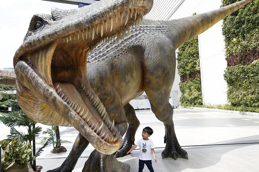 A model of the dinosaur Siamosaurus suteethorni on display outside a shopping mall in Bangkok, Thailand, yesterday. Siamosaurus suteethorni was a theropod dinosaur species that lived during the early Cretaceous period more than 100 million years ago.