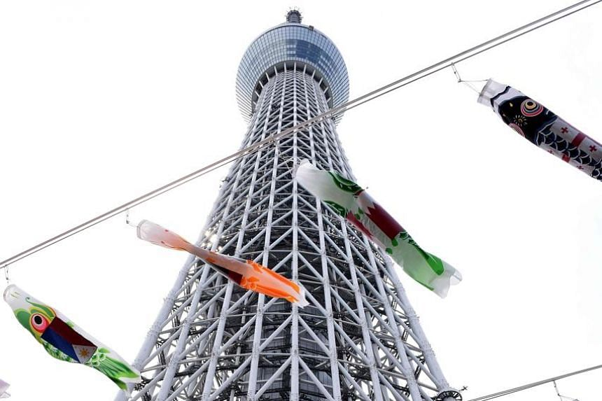 Carp-shaped windsocks outside the Tokyo Skytree in Japan's capital set the stage for tomorrow's Children's Day festivities. The annual holiday is a time for honouring children and for wishing them happiness. In Japanese culture, the carp is a symbol