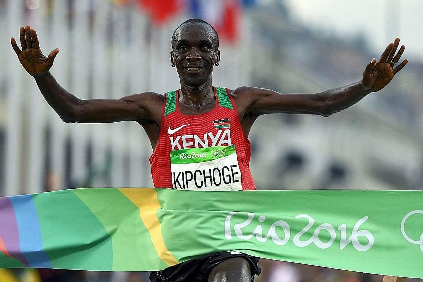 Kenya's Eliud Kipchoge crossing the finish line first in the Rio Olympics marathon last year. He is one of three runners attempting to break the two-hour mark in running the 42.195km race this weekend.