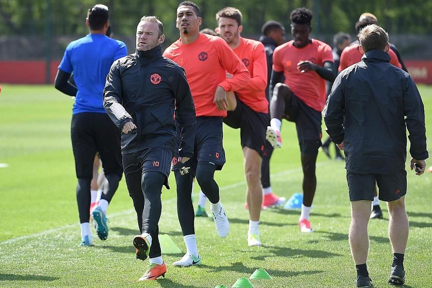 Manchester United skipper Wayne Rooney leading his team-mates, including a returning Chris Smalling, during a training session ahead of their Europa League semi-final game with Celta Vigo. Smalling's return to fitness will be much welcomed by his coa