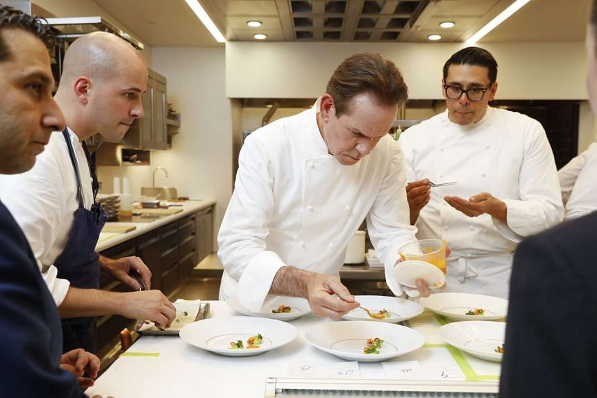 Chef Thomas Keller, with other staff, plates food in the renovated kitchen at French Laundry in Yountville, California.