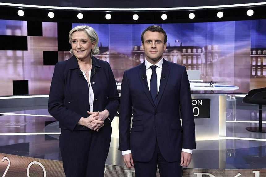 French presidential election candidates Marine Le Pen (left) and Emmanuel Macron at a televised debate.
