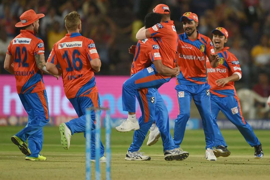 Gujarat Lions cricketers celebrate after the dismissal of Rising Pune Supergiants cricketer Manoj Tiwary during the 2017 Indian Premier League (IPL) Twenty20 cricket match.