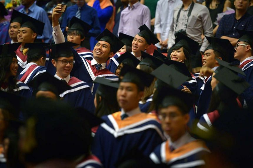 Graduating students at an NTU Commencement ceremony.