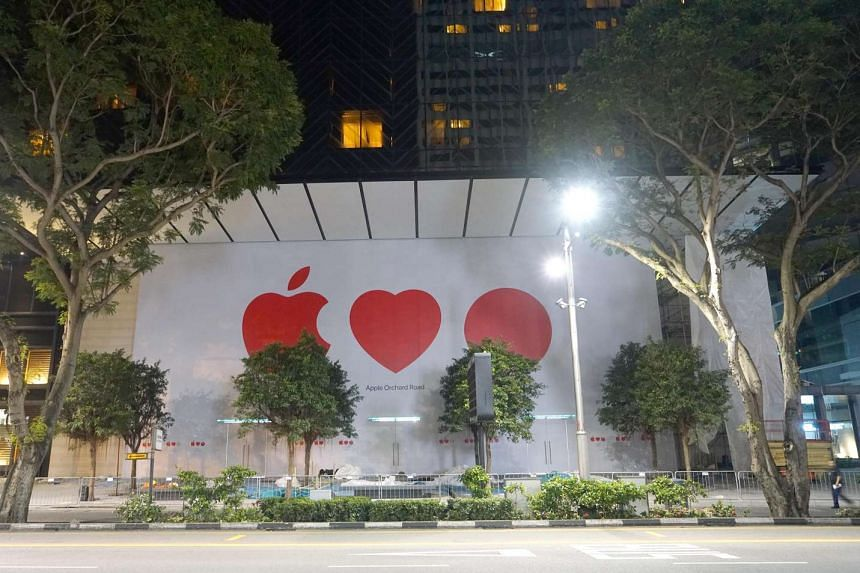 Barricades were removed at the Apple Orchard Road store to reveal the Apple Loves Red Dot (Singapore) icons on Wednesday night.