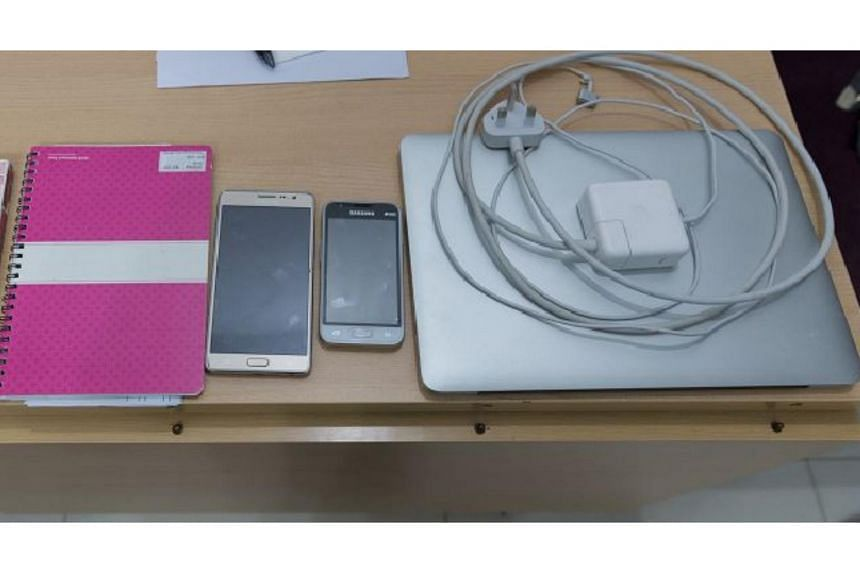 During the operation, 13 mobile phones, 4 laptops, a tablet computer, condoms and related documents were seized as case exhibits.