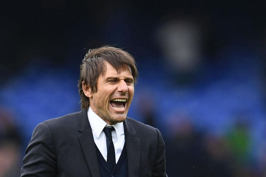 Chelsea's head coach Antonio Conte celebrates victory at the end of the English Premier League football match between Everton and Chelsea at Goodison Park in Liverpool, north west England on April 30, 2017.