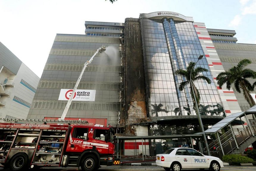The fire was confined to the facade of the building at 30 Toh Guan Road, located opposite the IMM mall in Jurong East.