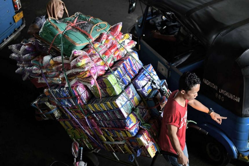 A cart filled with textile packages at South-east Asia's largest textile wholesale center, Tanah Abang market, in Jakarta.