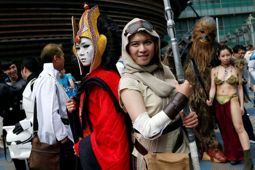 Fans dressed as the characters from Star Wars react during Star Wars Day in Taipei, Taiwan.
